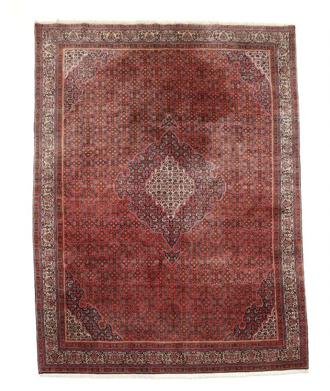 A Persian Bidjar carpet, classic angular medallion design with herati pattern on red base. 20th century second half. 364×257 cm.