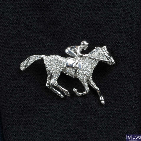 A limited edition 18ct gold diamond horse and jockey brooch.