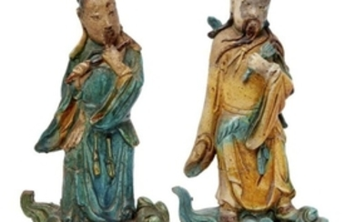 A pair of Chinese pottery figural roof...