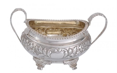 A George IV silver twin handled oval sugar basin