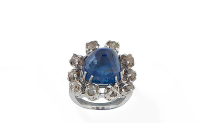 A sapphire and coloured diamond dress ring