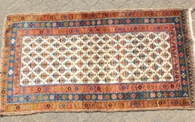 A KURDISH PERSIAN TRIBAL RUG with a key row of motifs