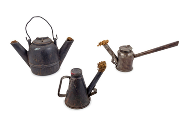A Group of Three Railroad Metal Torches