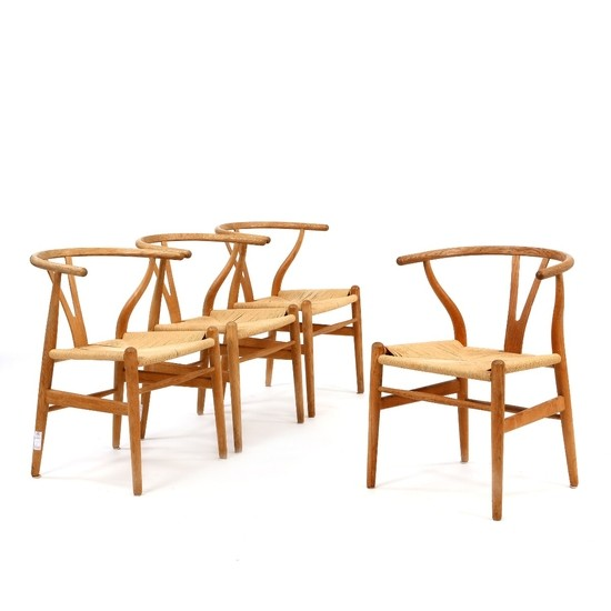 "Hans J. Wegner: ""Y-Chair/The Wishbone Chair"". Set of four armchairs with oak frame. Seats stretched with woven papercord. (4)"