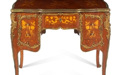 A Louis XV Style Gilt Bronze Mounted Marquetry Desk