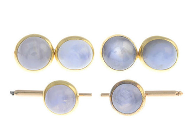 A star sapphire cabochon dress set, comprising a pair of cufflinks and two dress studs.