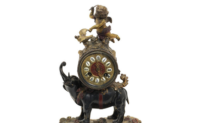 A late 19th century French patinated and gilt bronze figural mantel clock
