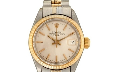 A lady's stainless steel and fourteen karat gold