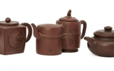 Three Chinese Yixing teapots, early 20th century,...