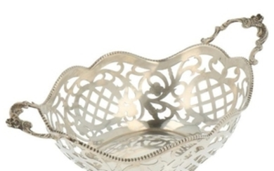 Bonbon basket with ajour openwork side finished with soldered pearl rim and cast handles silver.
