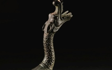 AN EXCEPTIONALLY RARE BRONZE DRAGON-FORM SUPPORT HAN DYNASTY