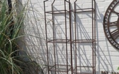 A Pair of hand forged wrought iron square garden obelisks wi...