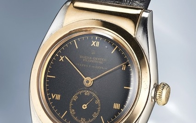 Rolex, Ref. 3064 A remarkable, impressive and extremely rare yellow gold and stainless steel wristwatch with black dial