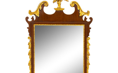 A George III Style Parcel Gilt and Carved Mahogany Mirror