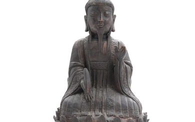 A Ming style patinated bronze figure of a Taoist goddess, seated at lotus throne. Presumably 20th century. H. 22 cm.