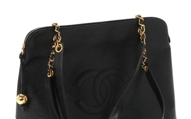 """Chanel: A """"Vintage Timeless Zip Tote"""" bag of black caviar calf leather, one big compartment, two zipped pockets and two handles. H. 32 x L. 43 x W .16 cm."""