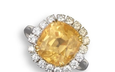 A yellow sapphire and diamond cluster ring, the cu…