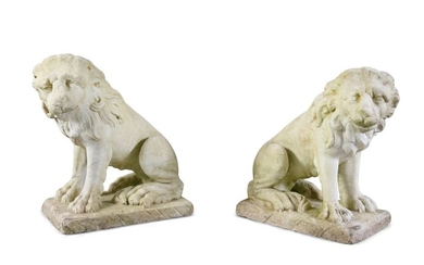 A PAIR OF CARVED MARBLE LIONS, seated, on rectangu…