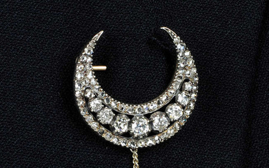 An early 19th century silver and gold, old and rose-cut diamond crescent brooch.