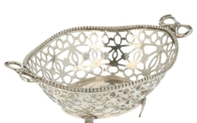 Bonbon basket on feet with ajour openwork side and soldered pearl edge and bow handles silver.