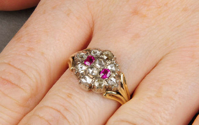 An early 19th century silver and gold cluster ring, with replacement rose-cut diamonds and rubies.