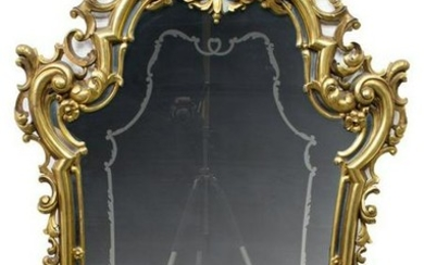 FRENCH LOUIS XV STYLE SHAPED GILT WOOD MIRROR