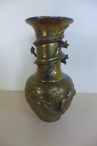 An Oriental bronze dragon vase, with character marks to base...