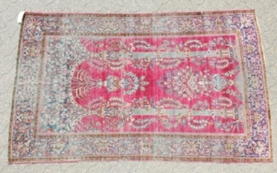 AN ANTIQUE PERSIAN KASHAN SILK RUG with floral design