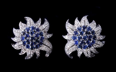**LOT WITHDRAWN** A pair of sapphire and diamond flower head earrings