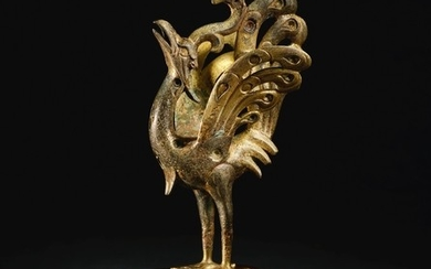 A SPLENDID AND RARE GOLD AND SILVER-INLAID PARCEL-GILT BRONZE FIGURE OF A PEACOCK HAN DYNASTY