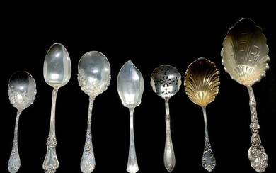 Assortment of Silver Serving Pieces and Flatware.