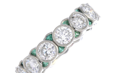 A diamond and emerald full eternity ring.