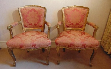 A pair of French upholstered bedroom armchairs on cabriole l...