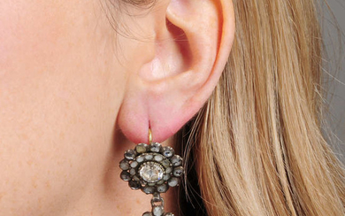 A pair of Georgian silver circular and pear-shape paste cluster drop earrings.