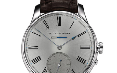 MORITZ GROSSMANN RÉSERVE DE MARCHE CLASSIQUE Power-reserve indicator in white and blue Design with black Roman numerals and the Moritz Grossmann logo in typography dating from 1875. Signature of manufactory founder Christine Hutter on the back,