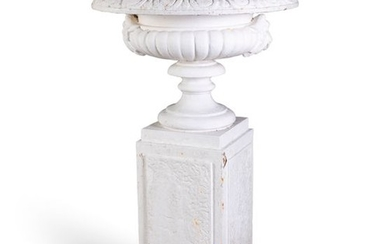 A VICTORIAN CAST IRON GARDEN URN, the broad top wi…
