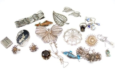 A group silver and white metal jewellery includes enamel art...