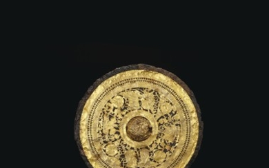 A GOLD FOIL-DECORATED IRON MIRROR, LATE EASTERN HAN-EARLY SIX DYNASTIES PERIOD OR LATER