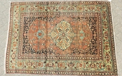 AN OLD PERSIAN TABRIZ RUG with large central motif and