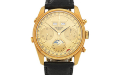 Heuer. An 18K gold manual wind triple calendar chronograph wristwatch with moon phase