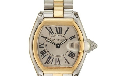 A stainless steel and gold bracelet wristwatch with