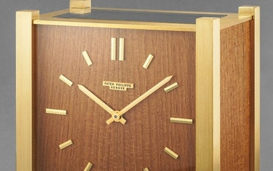 Patek Philippe, A highly rare and attractive squared-shaped gilt brass and teak desk clock with solar panel