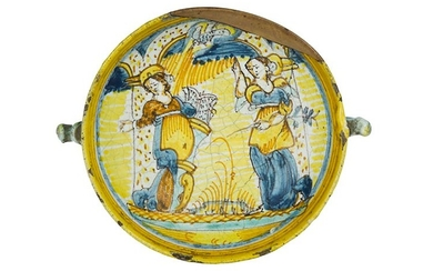 Bowl Bowl with two elaborate handles. Majolica painted in polychromy...