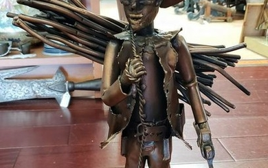 Cowboy with Bundle of Sticks Welded Copper Sculpture by