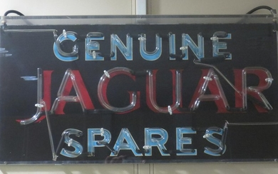 "A ""Genuine Jaguar Spares"" neon advertising sign,"