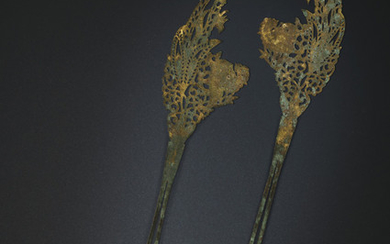 A PAIR OF PARCEL-GILT SILVER HAIRPINS, TANG DYNASTY (AD 618-907)