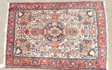 A PERSIAN BIDJAR RUG with a floral centre, motif and
