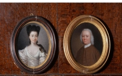 Jan Godfrey (British 18th century) A portrait of a lady ; together with another portrait of a gentleman by a different hand
