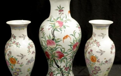 Three Chinese famille rose ceramic vases including a pair, b...