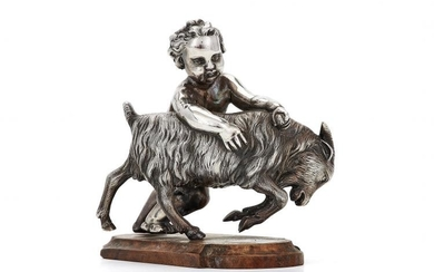 A Victorian silver model of a cherub with a billy goat